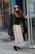Myleene Klass Looks classically elegant arriving at Smooth Radio with baby Apollo in London