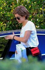 Nina Dobrev Arrives at a friend