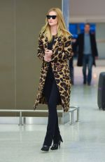 Rosie Huntington-Whiteley Stuns in an animal print coat as she arrives at JFK Airport in New York