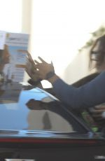 Selena Gomez and her team pictured arriving at a music studio with her dog in LA