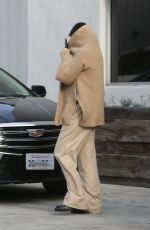 Selena Gomez Covers her face with her sweater leaving the dance studio in Burbank