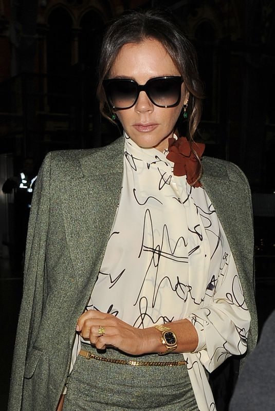 Victoria Beckham Arriving back in London
