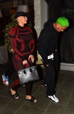 "Amber Rose and boyfriend Alexander ""AE"" Edwards kiss for the fans after dinner in Beverly Hills"