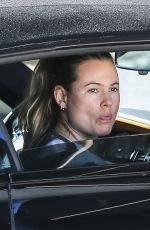 Behati Prinsloo Makes funny faces arriving with husband Adam Levine at the gym