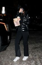 Camila Morrone Attempts to be incognito as she grabs a warm treat for her and Leonardo DiCaprio