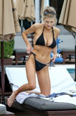 Charlotte Mckinney In black bikini soaks up some sun in Miami