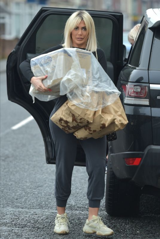 Chloe Ferry and Nat Phillips deliver food and clothing to Charity