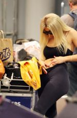 Chloe Ferry Shows off her derriere in tight Black leggings as she