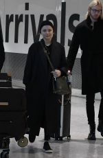 Chloe Moretz Arrives at Heathrow Airport in London
