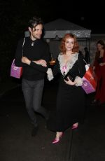 Christina Hendricks Walks arm in arm with a mystery man to a house party in Los Angeles