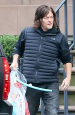 Diane Kruger and Norman Reedus are spotted out loading up an UBER SUV in New York