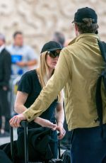 Ellie Goulding and husband Caspar Jopling are seen arriving on a flight at Miami International Airport in Miami