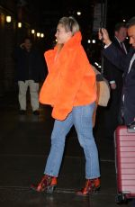 Florence Pugh Looks radiant in a fur orange coat in New York City