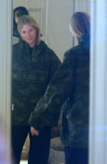 Gwyneth Paltrow Tries on a Jacket at the Dior Store in Aspen