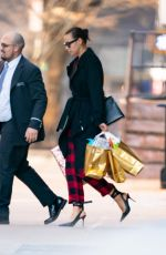 Irina Shayk Spotted Stepping Out on Christmas Day With Bags of Presents