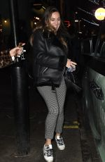 Kelly Brook Runs through Leicester Square to catch her Black Cab after presenting on Heart Radio in London