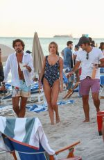 Kimberley Garner Shows off her fit figure in a blue one-piece on the beach in Miami