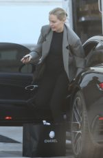 Lara Bingle Shows off her growing baby bump as she shops at chanel ahead of Christmas while in Beverly Hills