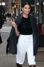 Lily Aldridge Heads into a building for business in New York