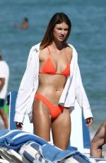 Lorena Rae In orange bikini on the beach in Miami
