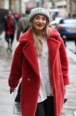 Megan McKenna Wrapped up in warm coat while she exits Kiss FM radio in London