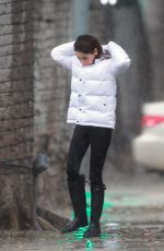 Mila Kunis Out on a rainy Sunday in Los Angeles