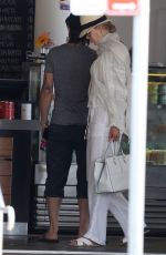 Nicole Kidman Beams in all-white while starting her morning with coffee run alongside hubby Keith Urban in Sydney