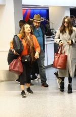 Nina Dobrev Catches a flight out of LAX with her parents in Los Angeles