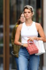 Pixie Geldof Braves the chilly London weather by donning her vest top and ripped jeans out in Soho