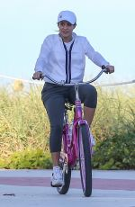 Shakira Riding a bike at the beach in Miami