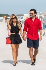 Sylvie Meis and her fiancee Nicals Castello are seen walking hand in hand in Miami Beach