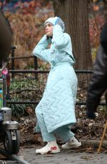 Zoey Deutch Seen wearing a baby blue full-length quilted coat filming