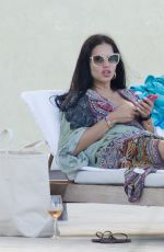 Adriana Lima In a bikini at a pool in Miami