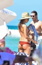 Alessandra Ambrosio In red on the beach in Florianópolis