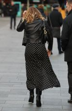 Amanda Holden Looks hot in black polka dot dress while she exits the Heart Radio Studios in London