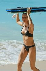 Andriy Shevchenko and wife Kristen Pazik pictured on the beach in Barbados