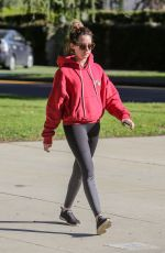 Ashley Tisdale Sports a red hoodie and black leggings for a walk in Los Feliz
