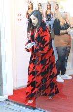 Becky G Sports red and black as she arrives at a meet and greet in Hollywood