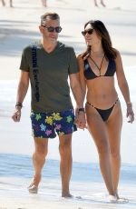 Duncan Bannatyne and wife Nigora Bannatyne pictured enjoying a romantic stroll in Barbados