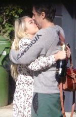 Florence Pugh Shares a kiss with boyfriend Zach Braff as they toast her Oscar nomination with a bottle of champagne in London