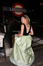 Georgia Toffolo Braves the cold as she boards the underground at Knightsbridge in her Costarellos dress