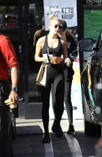 Hailey Bieber Shows off her abs as she steps out of the gym in West Hollywood