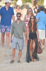 Izabel Goulart and Kevin Trapp walk the beach in St Barth