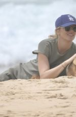 Jasmine Yarbrough Seen with her husband on the beach in Noosa