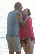 Julie Graham and her husband Davy Croket kissing on the beach in Barbados