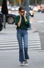 Kaia Gerber Looks busy on the phone as she visits Alfred