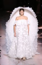 Kaia Gerber Walks the runway during the Givenchy haute couture Spring/Summer show in Paris