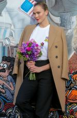 Karlie Kloss Waits for her Uber ride outside a studio in Los Angeles