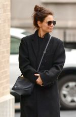 Katie Holmes Shares a shy smile early morning in a cold New York day
