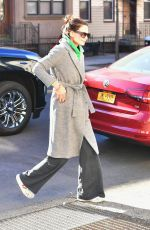 Katie Holmes Steps out to grab painting supplies wearing a bathrobe and a tracksuit
